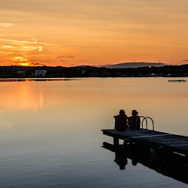 Silent by Christian Krammer - People Couples ( clouds, silent, reflection, footbridge, silhouette, sunset, summer, couple, lake, summertime,  )