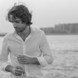 Wandering by Ali Sabbagh - People Portraits of Men ( model, sepia, fashion, smoking, male, sea, beash, bnw, man )