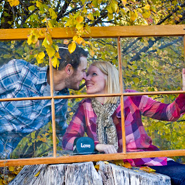 by Brandon Murphy - People Couples ( love, frame, window, blue, true love, gaze, pink, couple, smile, enduring )