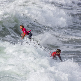 Surfers, Polzeath, Cornwall, UK by Steve Griffiths - Sports & Fitness Surfing ( surfer, wave, sea, fun, surf, foam )