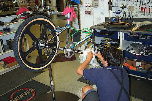 Bikes Shops In San Diego Jose working on bike