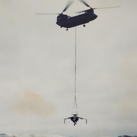 Giving a lift. by DTphotography Nikon Lumix - Transportation Helicopters ( chinook, war, \south atlantic, harrier, uk forces, 1982, falkland islands, raf stanley, falklands war, runway, aircraft, boeing, royal air force, conflict, malvinas )