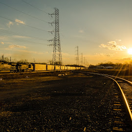 There Goes the Sun (and 18N) by Jacob Hoehler - Transportation Trains ( 18n, platform, ns, norfolk southern, station, 9242, new jersey, freight train, into sun, freight, train, nj, bound brook, auto rack )