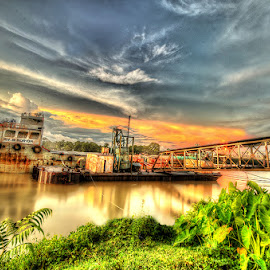 The Launch in the Sunset on River Barak by Manabendra Dey - Landscapes Cloud Formations ( clouds, hdr, sunset, long shutter, launch, long exposure, bracketing, cloud formation, slow shutter, barak river )