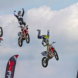 Motorbike Display Team In action  by Graham Mulrooney - Sports & Fitness Motorsports ( uk, motorbike, british, display team, in the air, through the air, show, flying, england, honda, horizontal, newbury, motorcycle, stunt riding, berkshire )