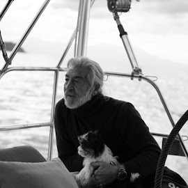 The captain and his dog by Terry Hannon - People Portraits of Men