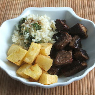 Veal Cubes With Coriander Rice And Fried Potatoes