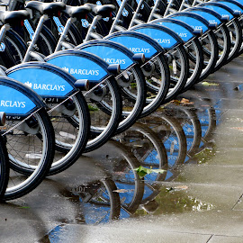 Fair Weather Cyclists by Mikki W - Transportation Bicycles ( london, boris, puddle, hire scheme, barclays, bicycle,  )