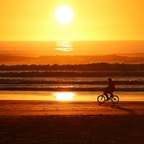 Beach Biker by Bill Waterman - Landscapes Sunsets & Sunrises ( waves, sunset, beach, seascape, landscape, people, ocean view )