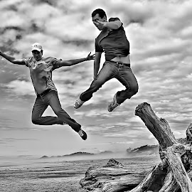 Jumpers by Gaylord Mink - People Street & Candids ( clouds, stump, beach, men, jump )