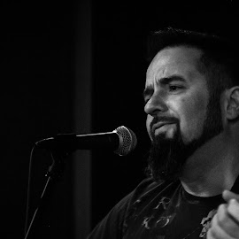 In The Moment by Antal Ullmann - People Musicians & Entertainers ( microphone, black and white, guitar, musician, portrait )