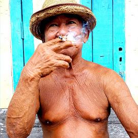 Indulgence  by William Liew - People Portraits of Men ( smoking, men, portraits, fisherman, island )