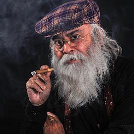 Man smoking cigar.. by Rakesh Syal - People Portraits of Men (  )