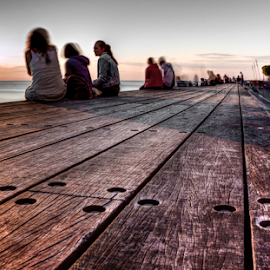 Chill out by Julija Moroza Broberg - City,  Street & Park  Vistas ( street, jetty, street scene, people, together, city, street life, details, relaxed, movement, lifestyle, gathering, pier, perspective, malmo, summertime, evening, sweden, neighborhood, community, relaxing, urban, malmoe, wooden, malmö, vista, warmth )