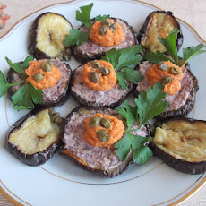 Roasted Eggplant Rounds Topped with Olive Tapenade and Artichoke-Roasted Red Pepper Spread