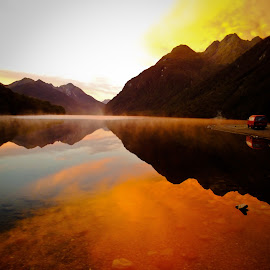 sunrise over lake by Pierre Husson - Landscapes Sunsets & Sunrises ( backpacking, lake & mountain, travel, sunrise, fiordland, aotearoa )
