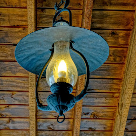 Shedding the Light by Barbara Brock - Buildings & Architecture Other Interior ( cabin light, wood ceiling, lantern, antique lantern, light bulb )