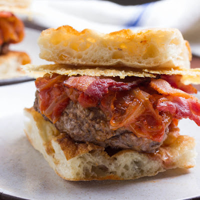 Amatriciana Burgers With Tomato-Onion Jam, Bacon, and Pecorino Romano Crisps