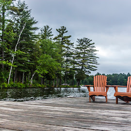 Getting Away by Rob Taylor - Landscapes Travel ( clouds, water, muskoka, relax, chairs, cottage, adirondack, lake, remote, quiet, storm, dock, Chair, Chairs, Sitting )
