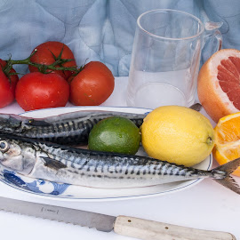 Vincent Van Gogh-Mackerel by Daniel Gorman - Food & Drink Meats & Cheeses ( lemons, van, mackerels, fish, grapefruits, still life, vincent, yellow, vincent van gogh, eat & drink, food & beverage, painting, knives, knife, meal, orange, sharp, green, plate, mackerel, lime, oranges, limes, tomatoes, tomatoe, red, plates, gogh, grapefruit, lemon,  )