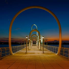 Baton Rouge River Boat Dock by Sheldon Anderson - Buildings & Architecture Other Exteriors ( structure, night photography, baton rouge, sunset, louisiana, dock, river, blue, orange. color )