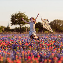 The joy of childhood. by Deborah Chetwood - Babies & Children Child Portraits ( wildflowers, girl, sunset, texas, bluebonnet )