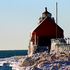 Light house  by Dipali S - Buildings & Architecture Other Exteriors ( famous place, harbour, ecosystem, american culture, architecture, beach, photography, local landmark, backwater, national landmark, cold, lakeshore, nature, freshwater, ice, state park, snow, maroon, pier, marina, industry, water surface, water, grand haven, park, scenics, lighthouse, lake, travel  destinations, vacations, natural landmark, canal, depression, history, michigan, red, north america, lake michigan, winter, building exterior, bay, horizontal, water's edge, outdoors )