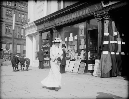 Woman walking past stationery shop on O'Connell (Sackville) Street