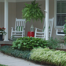 by Emilie Walson - Artistic Objects Furniture ( red door, white pillars, white rocking chairs, plants in foreground, porch )