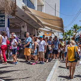 This is just the start of the queue. by Vibeke Friis - City,  Street & Park  Markets & Shops ( queue, sunny, waiting, street, people, crowd, humanity, society,  )