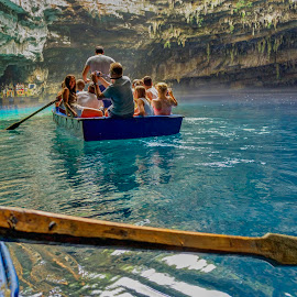 Melissani by Stratos Lales - Transportation Boats ( water, vacation, cave, boat, people )