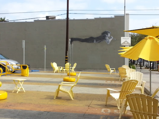 "The ""Flying Morrison"" mural complements Long Beach's new Park(d) Plaza, recovered from a portion of parking lot in the 400 block of East Fourth Street."