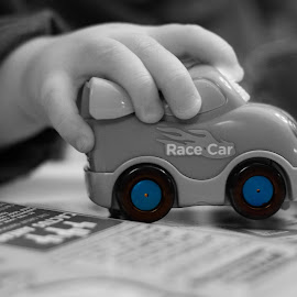 You can drive my car by Rick Hackley - Babies & Children Hands & Feet ( hand, car, toy, blue, black and white, play, baby boy )