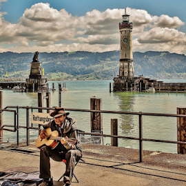 Playing for Coins! by Jesus Giraldo - City,  Street & Park  Street Scenes ( hdr, art, street, lake, guitar, germany, plaing, man, city )