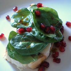 An Open Faced Sandwich of Kasseri, Spinach and Pomegranate