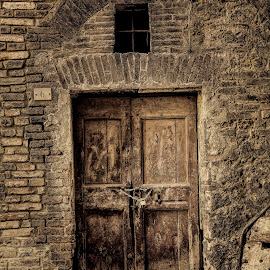 Closed for business by Gene Myers - Buildings & Architecture Other Exteriors ( shotsbygene, lock and chain, sepia, old door, street, bricks, old building, italy, siena, wall, gene myers,  )