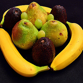 Fruits combinations. by Andrew Piekut - Food & Drink Fruits & Vegetables ( banana, grapes, green, avocado, yellow, black, pear )