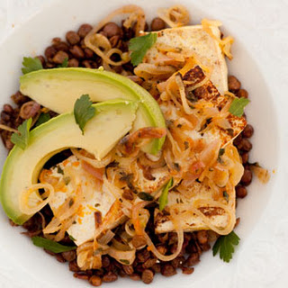 Orange-Shallot Tofu with Avocado Served on a Bed of Roasted Lentils