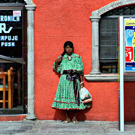Waiting for bus by Gaylord Mink - People Street & Candids ( building, woman, lady, standing, bus stop )