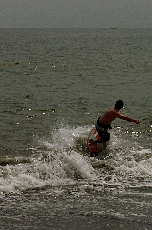 Jason skipping over a misguided wave