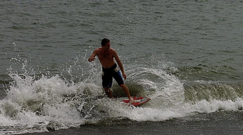 Jason pushing around a small wave