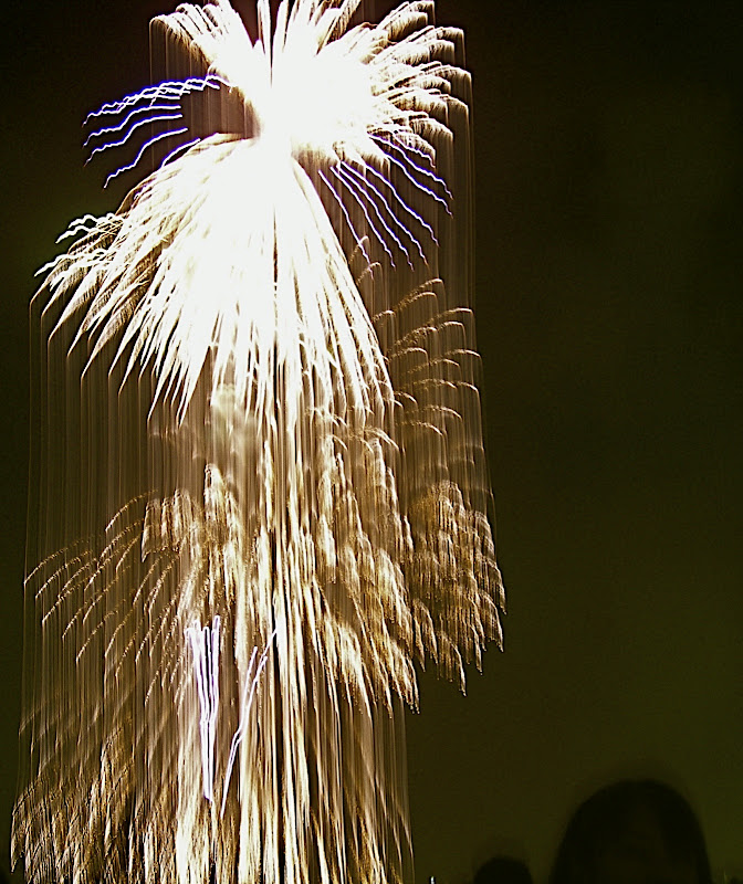 Someone looks at me in a fireworks shower