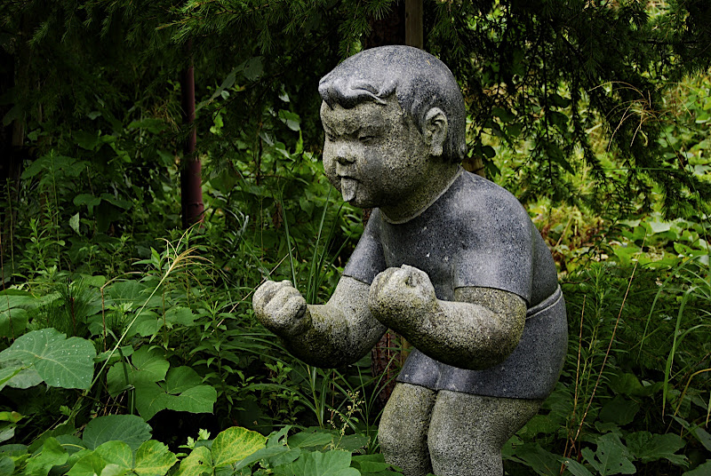 What this statues means I don't know, fight? newspaper time? tongue out?