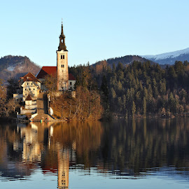 a church on the lake by Almas Bavcic - Landscapes Travel