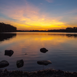 Sunset on lake by Brian Butters - Landscapes Sunsets & Sunrises ( water, orange, autumn, sunset, colors, fall, reflections, lake, october, rocks )