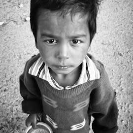 Innocent Eyes by Sauban Ahmad - Babies & Children Child Portraits ( children portrait, poverty, innocent eyes, children, children photography )