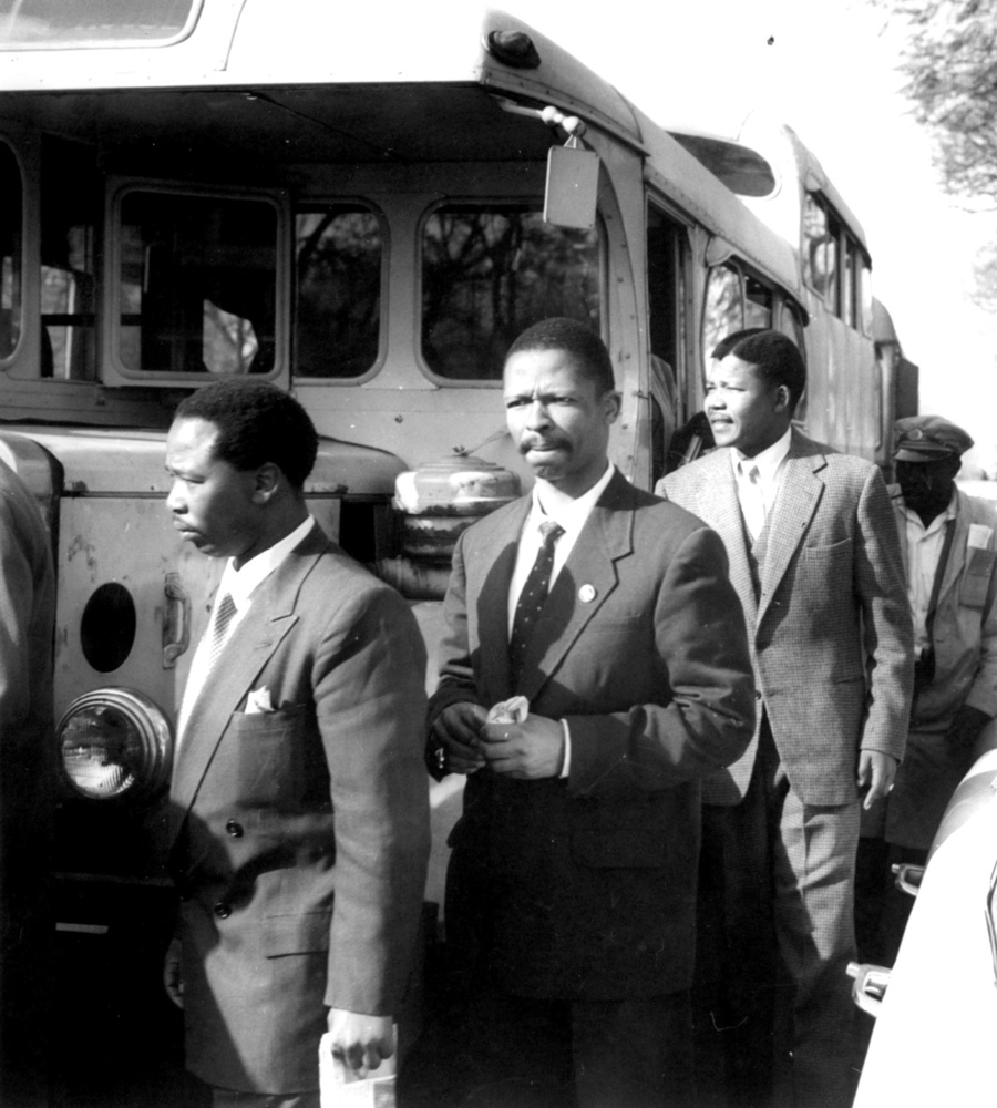 Nelson Mandela (third from left) arrives by bus