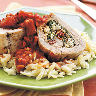 Spinach, Pesto, and Feta-Stuffed Pork Tenderloin with Chunky Tomato Sauce