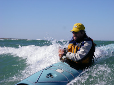 Henry Davies Surfing his Valley Pintail Sea Kayak on Lake Michigan.