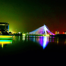 Putrajaya Night view by Alvin Ngow - Buildings & Architecture Public & Historical ( reflection, moods, colorful, location, travel, object, yellow, landscape, kuala lumpur, city, inspiration, night photography, emotions, asia, long exposure, deck, place, light, evening, water, purple, night scene, decoration, green, buildin, putrajaya, beautiful, malaysia, lake, happiness, waterscapes, nightscape, landmark, night view, lighting, color, background, device, lamp, night, bright lights, scenery, bridge, view, mood factory,  )